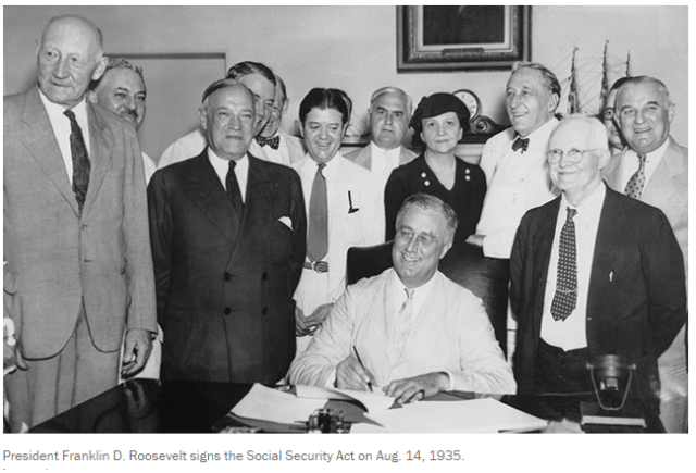 President FDR signs the Soc Sec Act